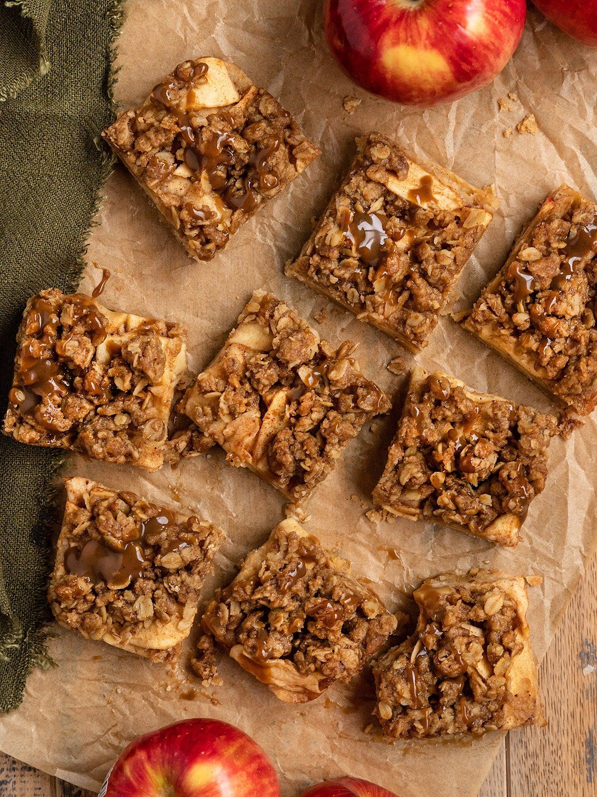 overhead shot of apple bars with streusel topping on parchment paper