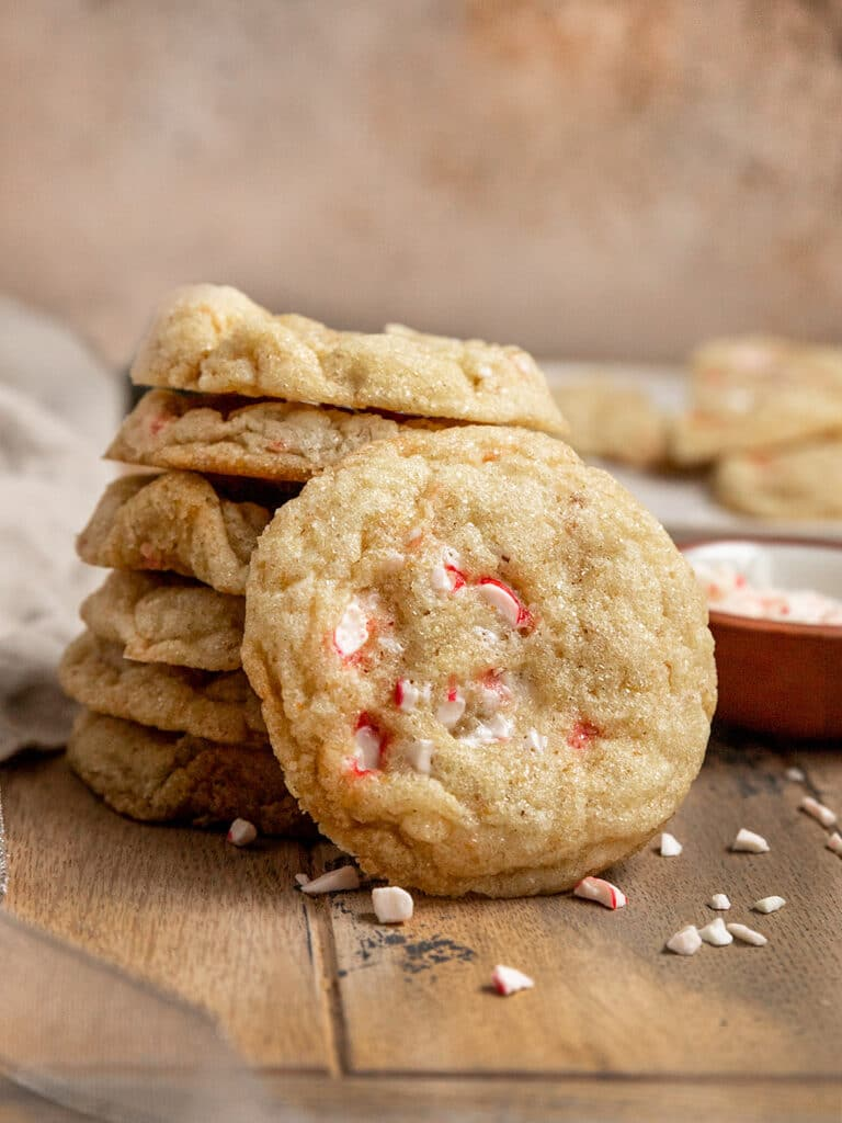 peppermint candy cookie leaning against a stack of five more cookies