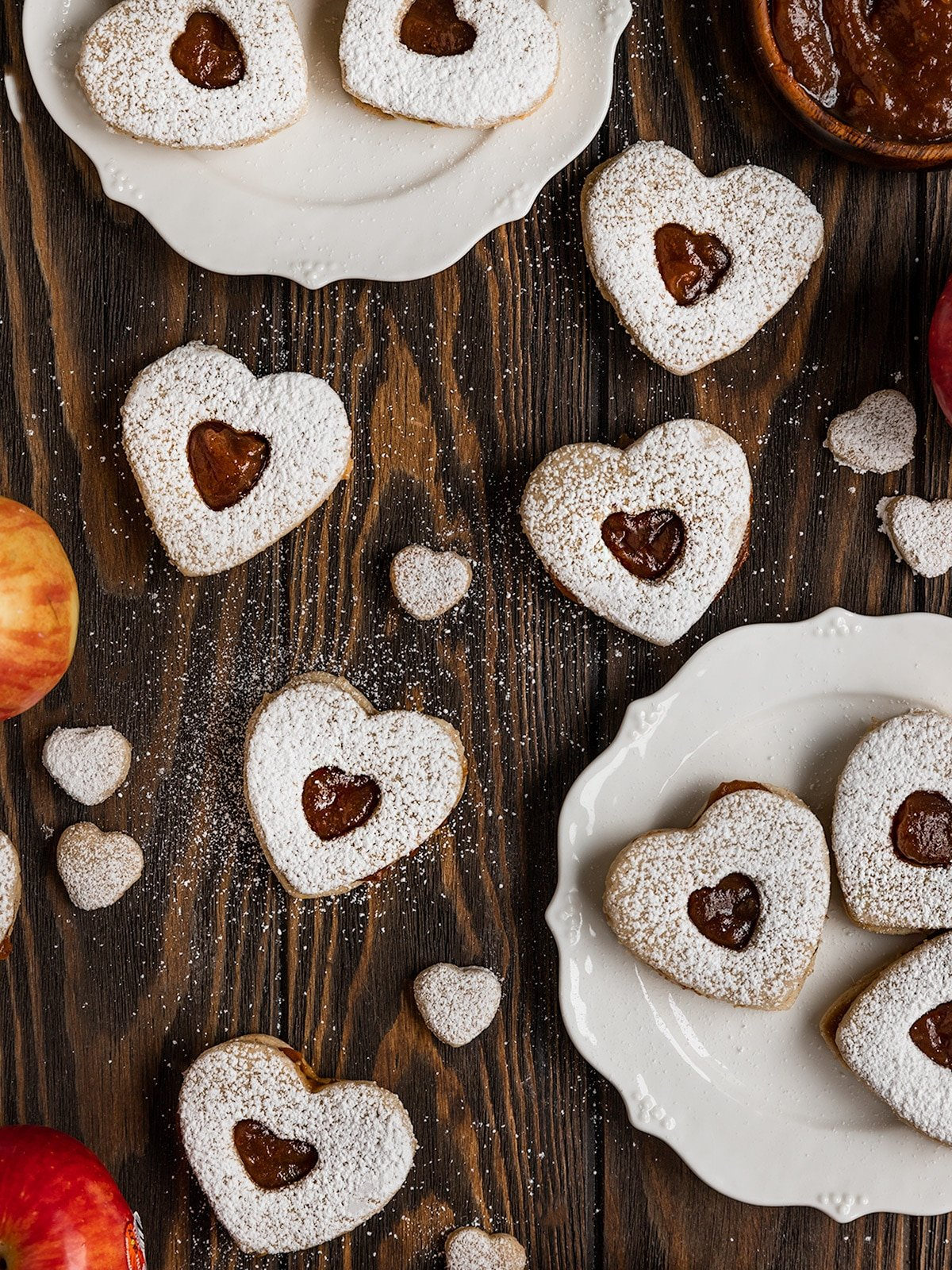 overhead shot of heart shaped cookies filled with apple butter