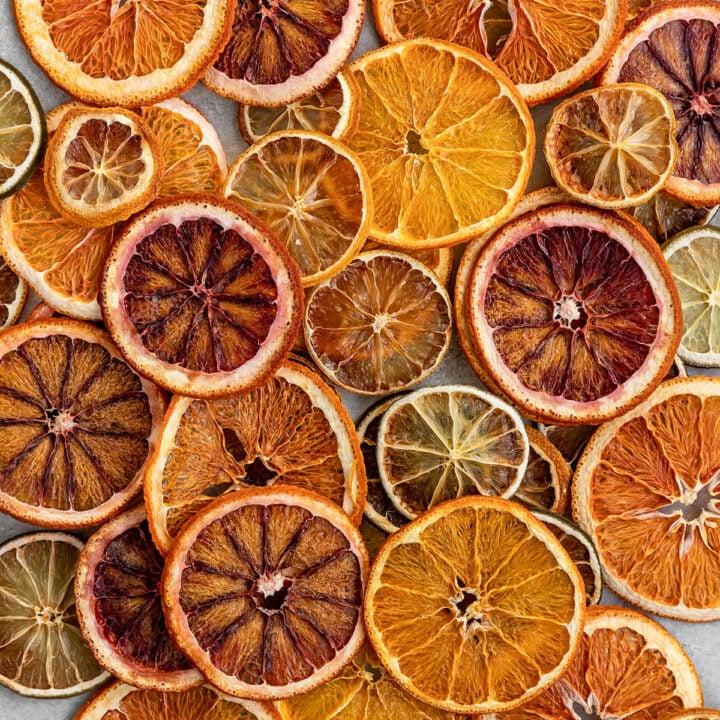overhead shot of dried citrus wheels including blood oranges, navel oranges, limes, and lemons