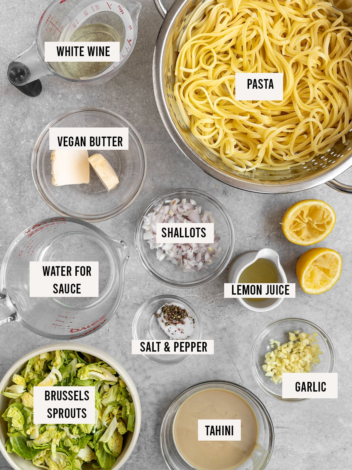 labeled ingredients for pasta including vegan butter, shallots, garlic, lemon juice, brussels sprouts, garlic, tahini, white wine