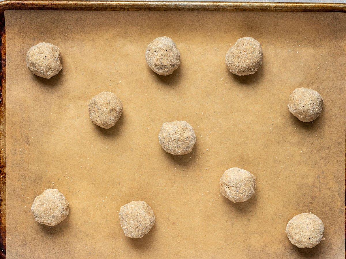 raw cookie dough balls on baking sheet before baking