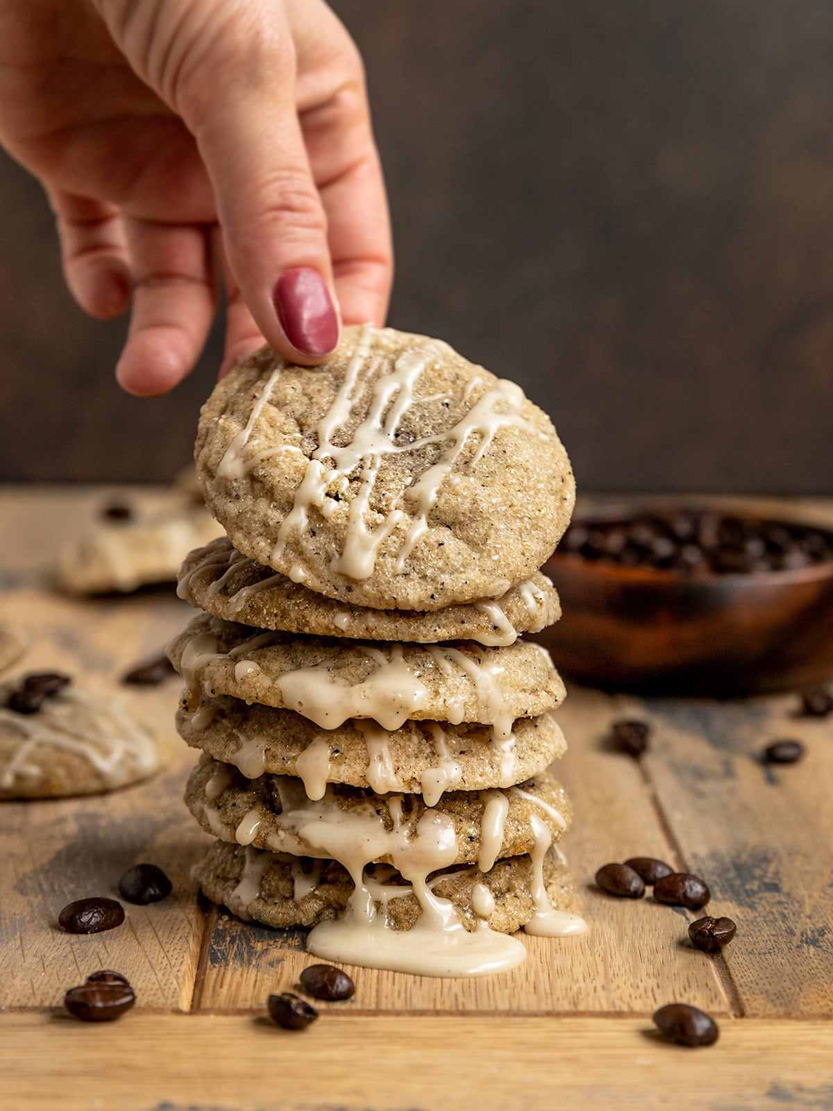 hand picking up top cookie from a stack of cookies