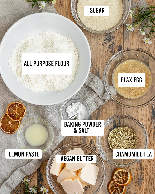 overlay of chamomile cookie ingredients including flour, lemon paste, flax egg, chamomile tea, sugar, baking powder, salt, and vegan butter