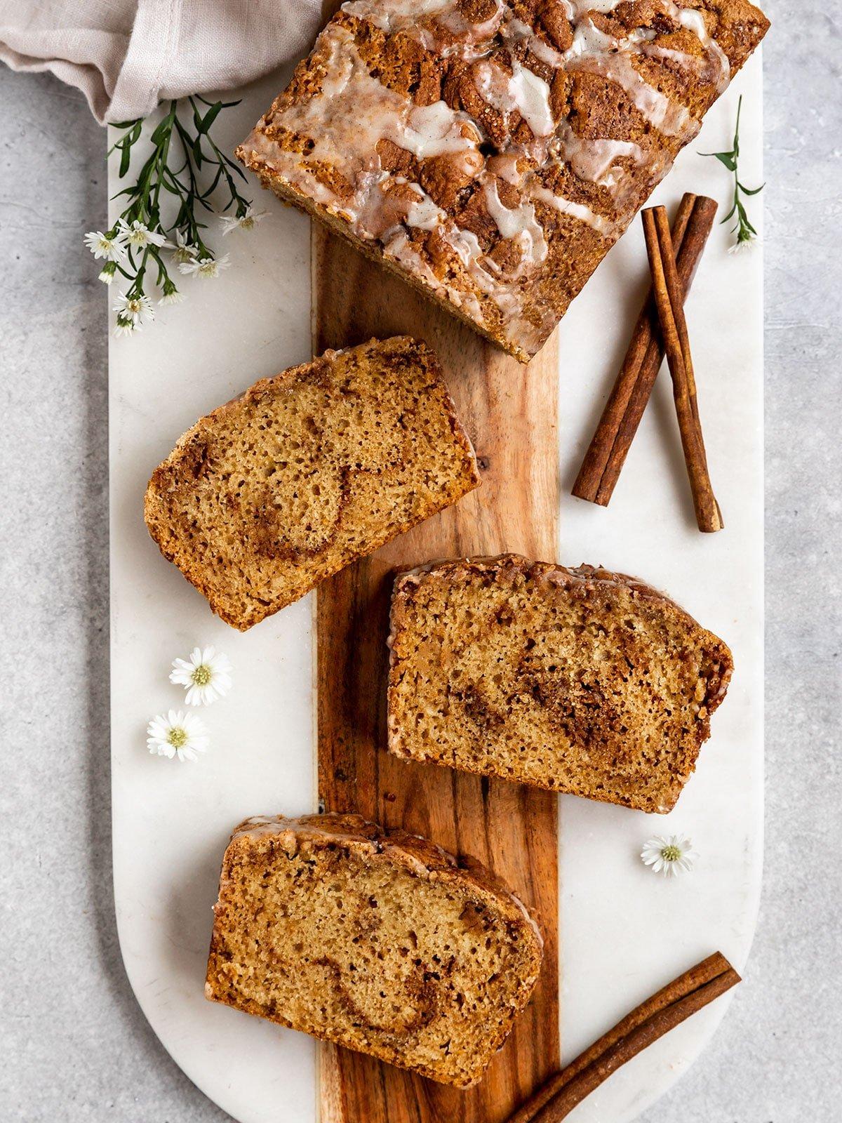 overhead shot of three slices of cinnamon bread with swirls of cinnamon sugar inside
