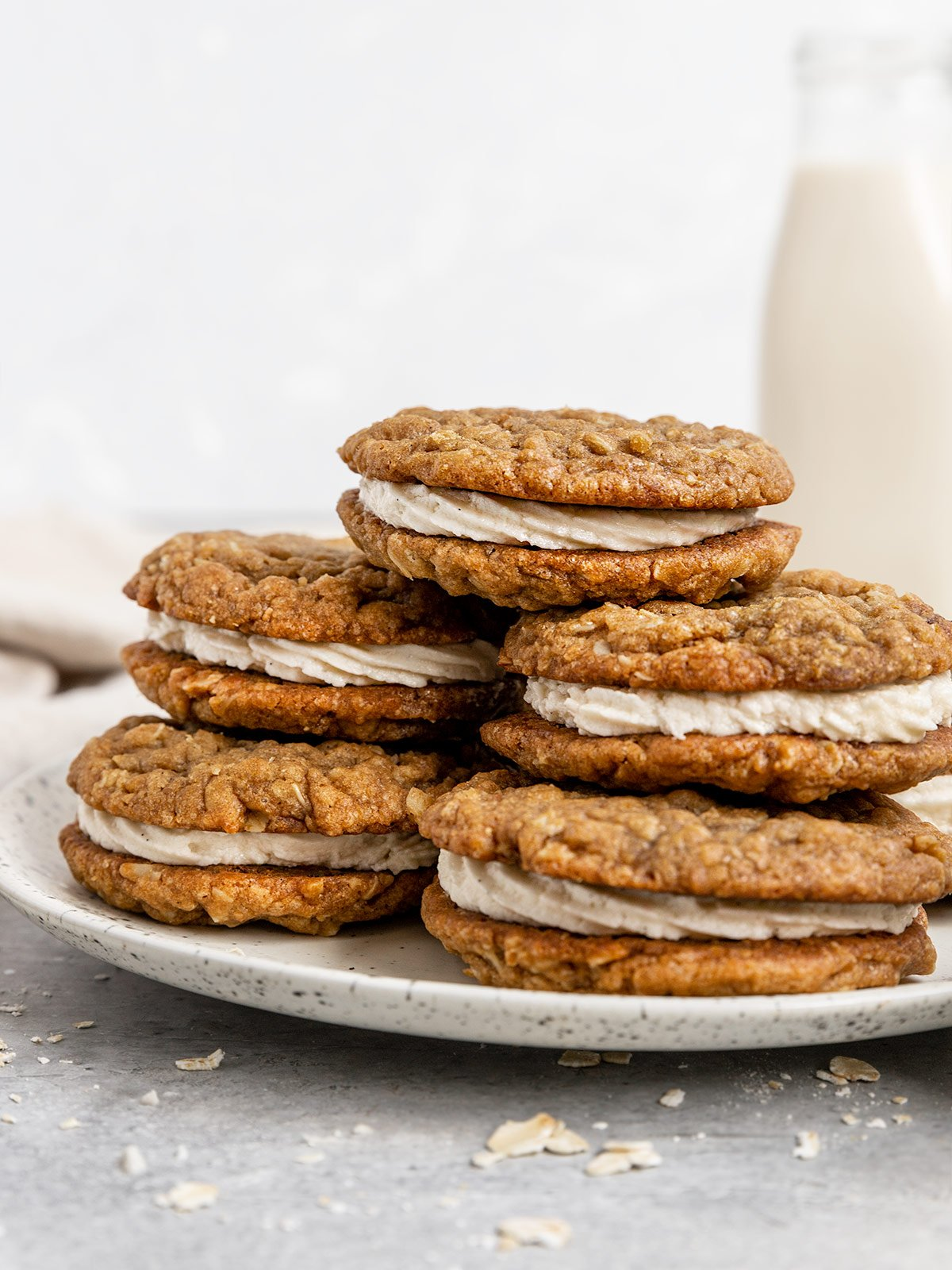 plate of stacked oatmeal cream pies with vanilla buttercream between two oatmeal cookies