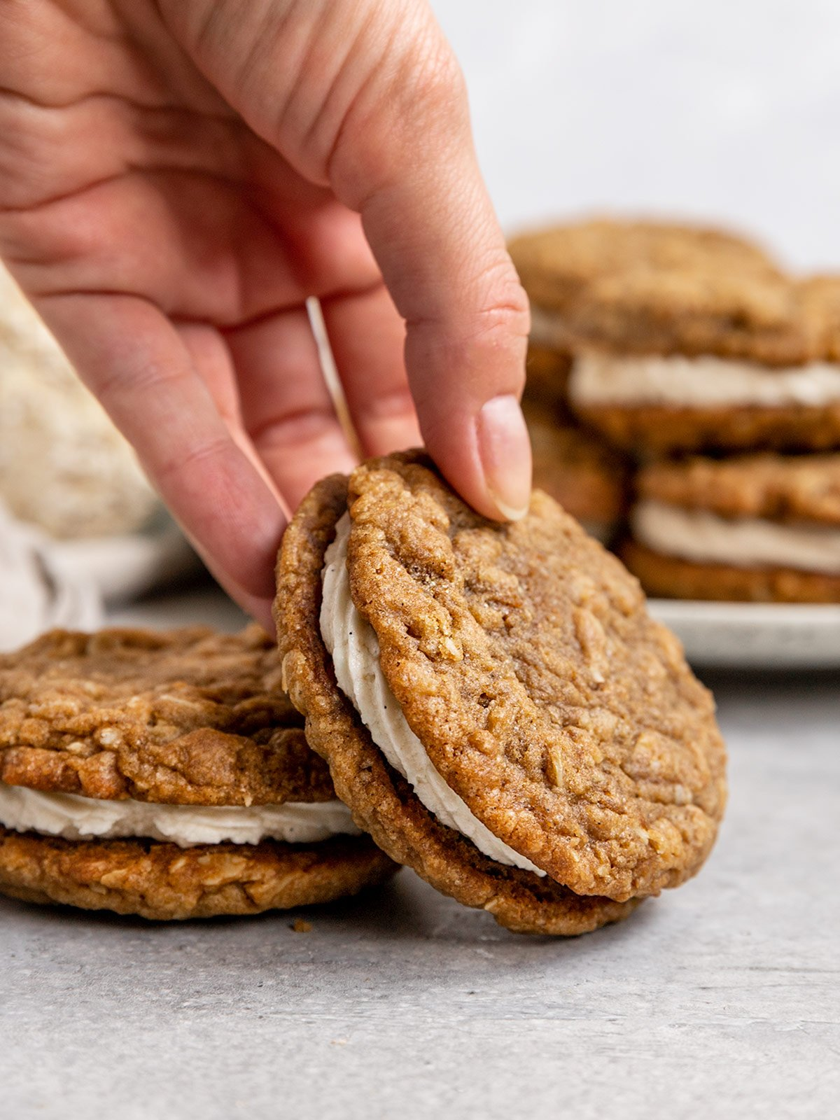 hand picking up an oatmeal cream pie cookie