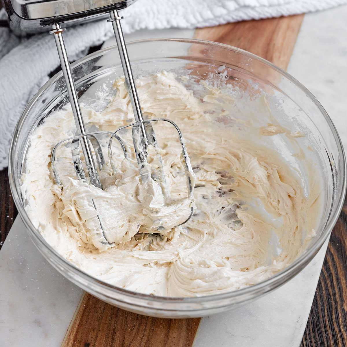 a bowl of whipped maple buttercream frosting