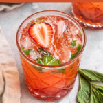 "a picture of a strawberry mint cocktail with the text ""Strawberry Mojitos, Easy & 8 simple ingredients!"""