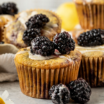 """picture of blackberry muffins with text """"blackberry lemon muffins, vegan & dairy-free!"""""""