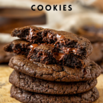"""picture of chocolate cookies with text overlap """"Vegan Double Chocolate Chip Cookies, chewy & fudgy!"""""""