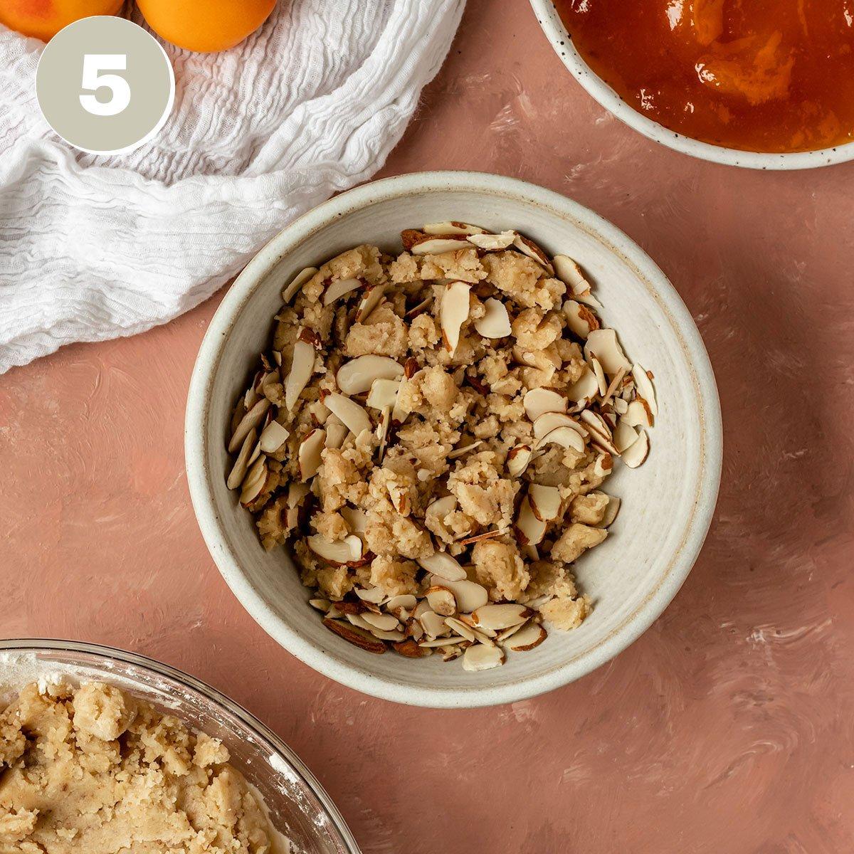 a bowl of a shortbread almond crumble