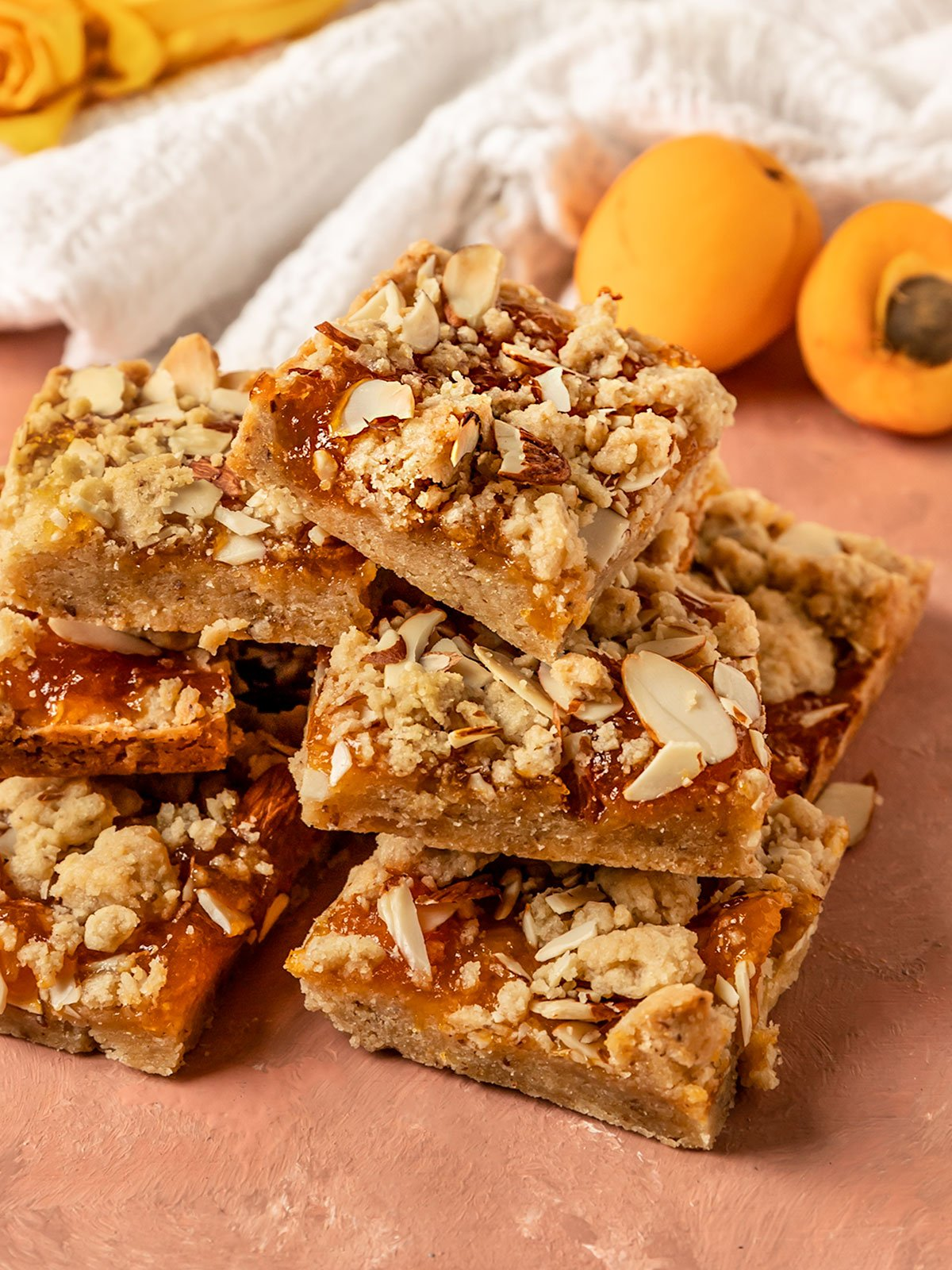 large stack of 7 apricot jam bars stacked on top of eachother