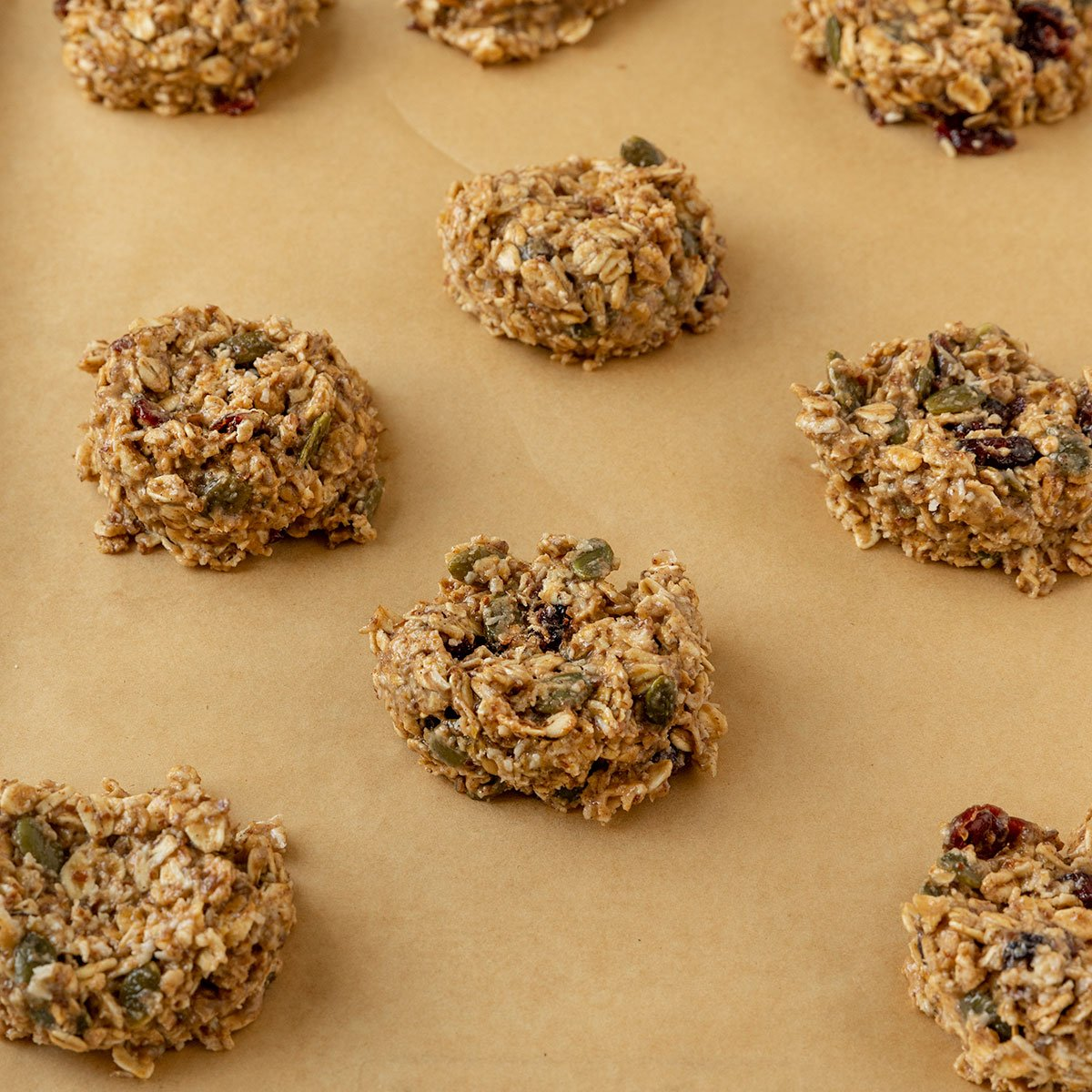 scooped breakfast cookies on parchment lined baking tray before baking