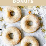"""donuts on parchment paper with text overlay """"vegan champagne donuts, festive & perfect for NYE!""""."""