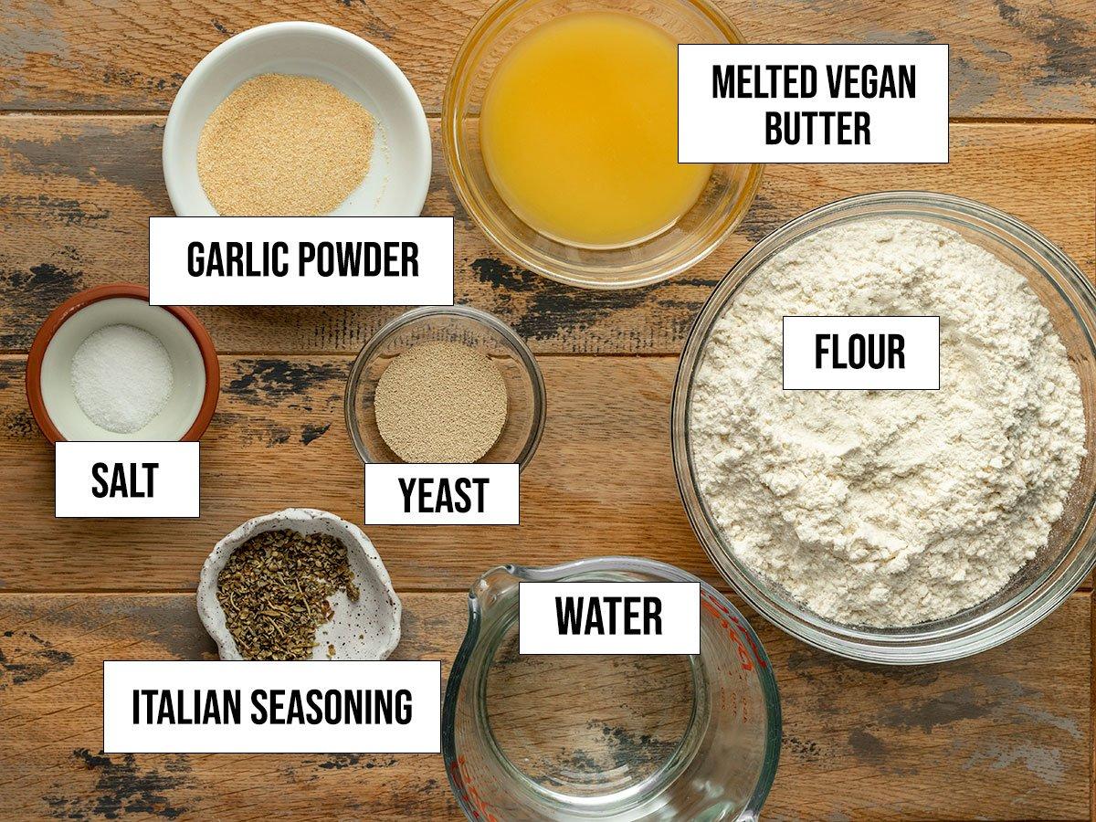 ingredients including flour, vegan butter, yeast, garlic powder, salt, italian seasoning, and water