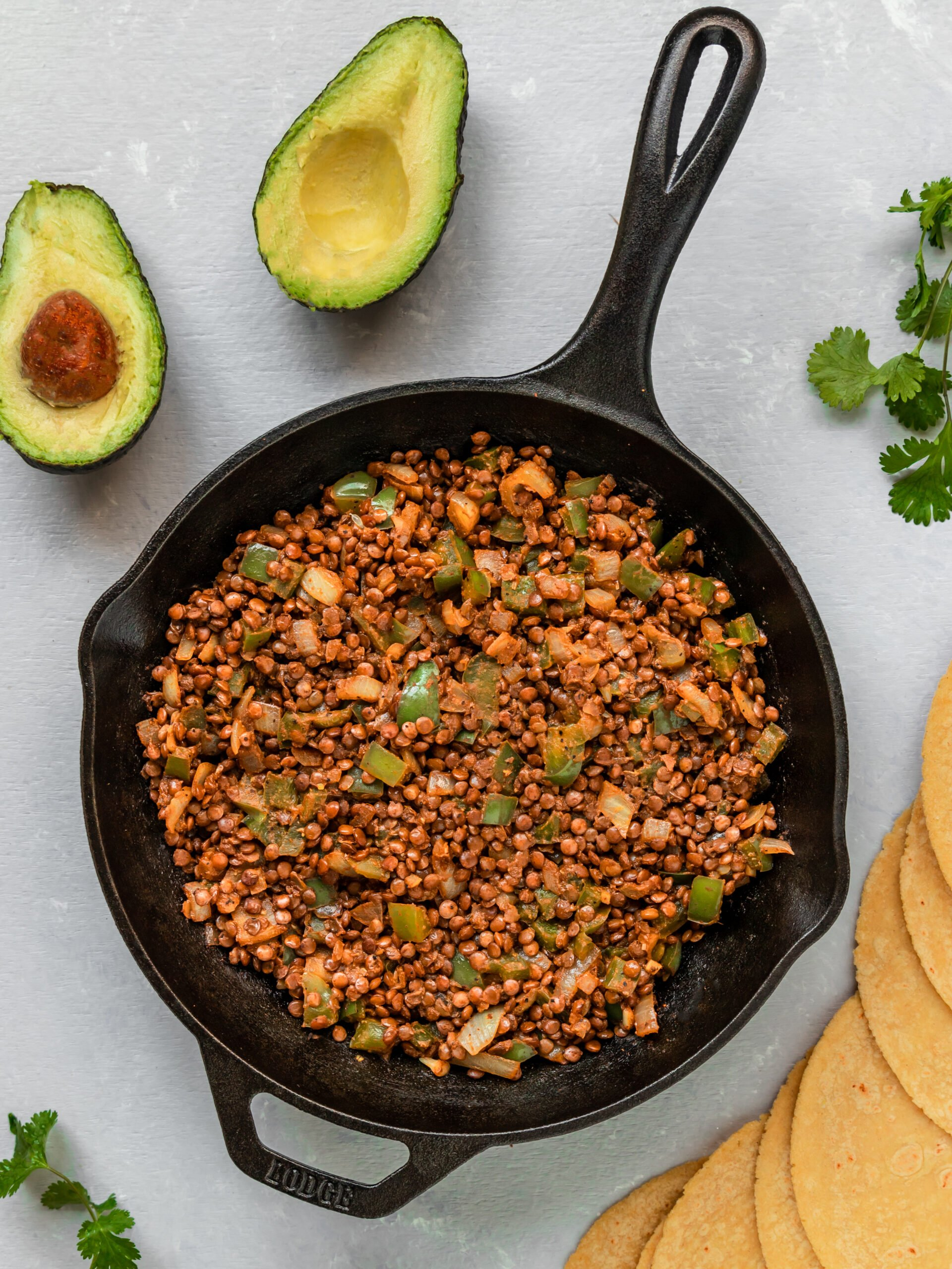 cooked lentil vegetable taco filling in cast iron pan