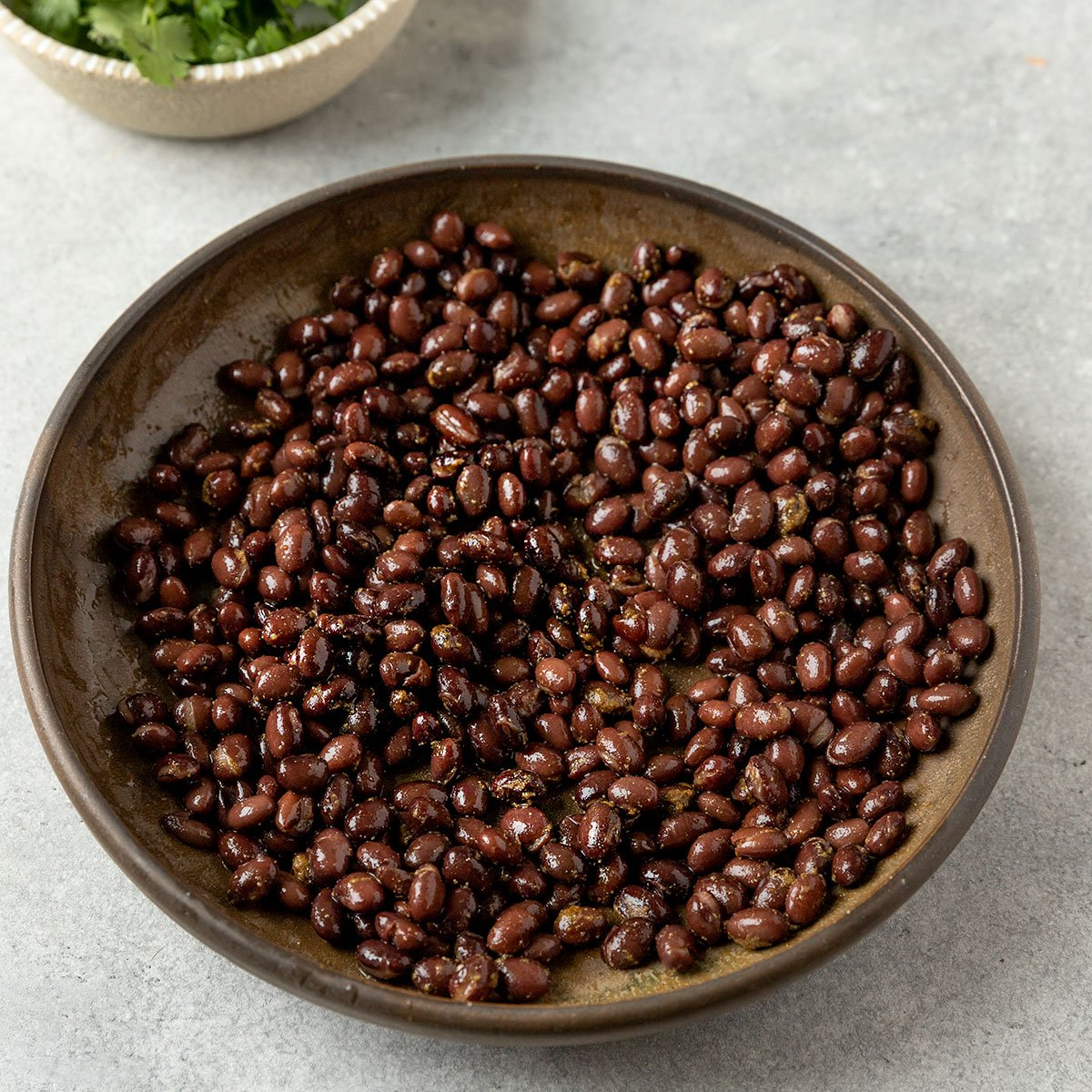 bowl of marinated cooked black beans