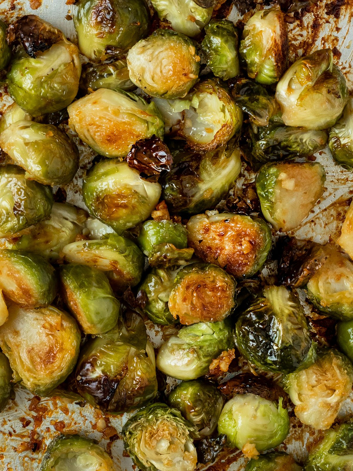 close up shot of roasted brussel sprouts that are charred on the edges