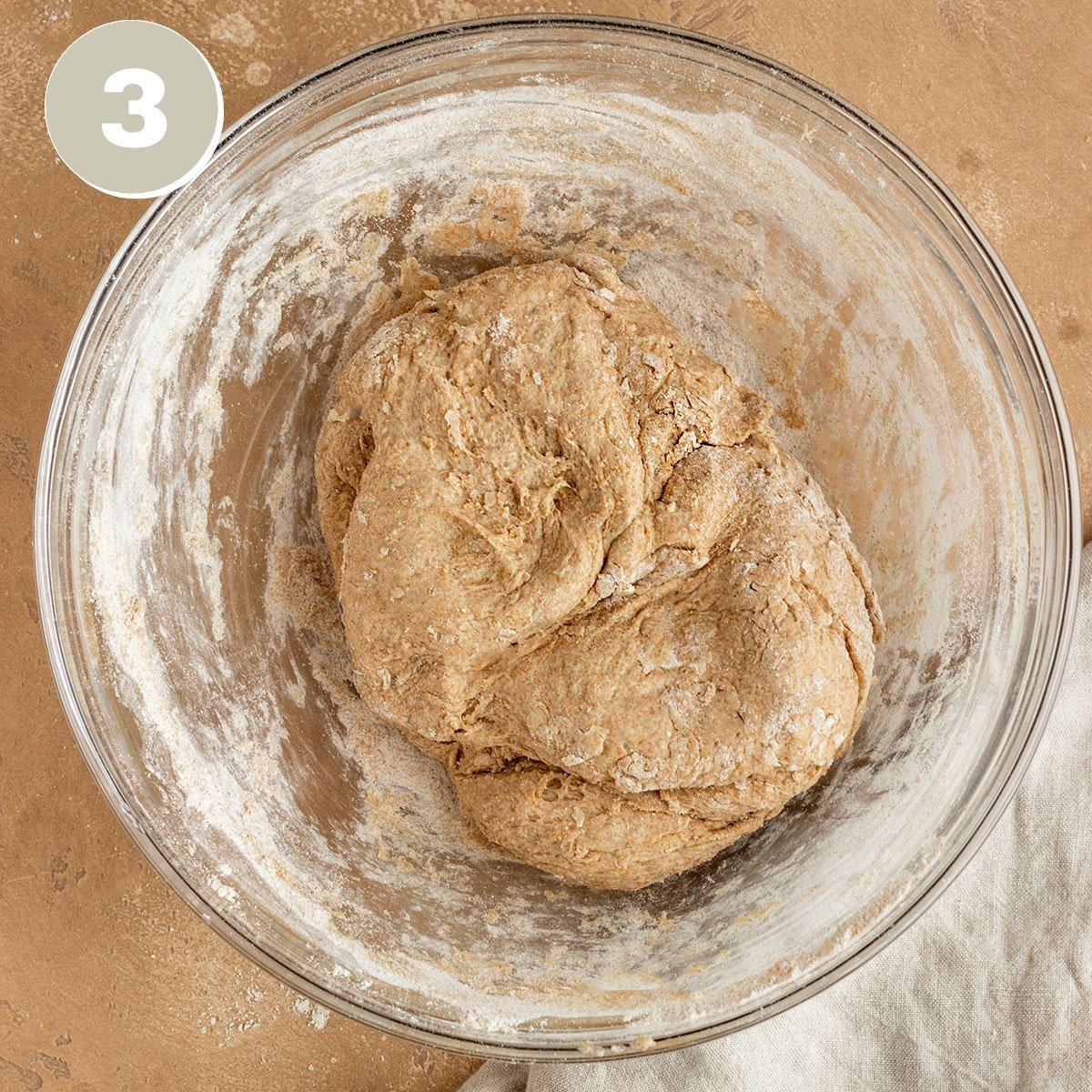 mixing bowl of spelt bread dough before kneading