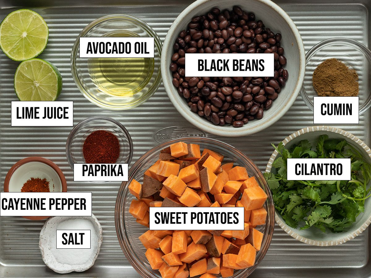 ingredients including sweet potatoes, black beans, avocado oil, cilantro, lime juice, salt, cumin, paprika, cumin, and cayenne pepper