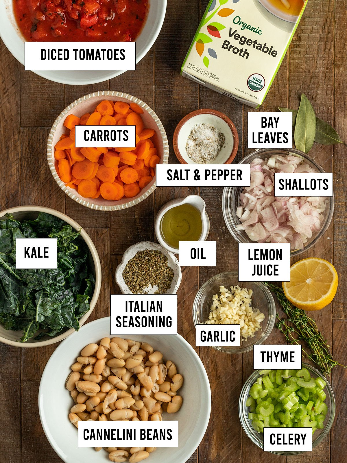 ingredients including carrots, kale, tomatoes, shallots, garlic, cannelini beans, celery, spices, salt, vegetable broth, lemon juice, oil, and bay leaves.