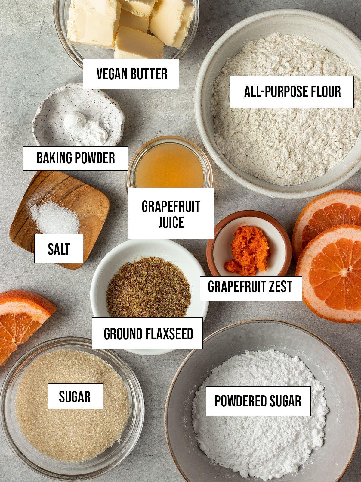 ingredients like flour, sugar, grapefruit juice, grapefruit zest, salt, baking powder, vegan butter, flaxseed, and powdered sugar