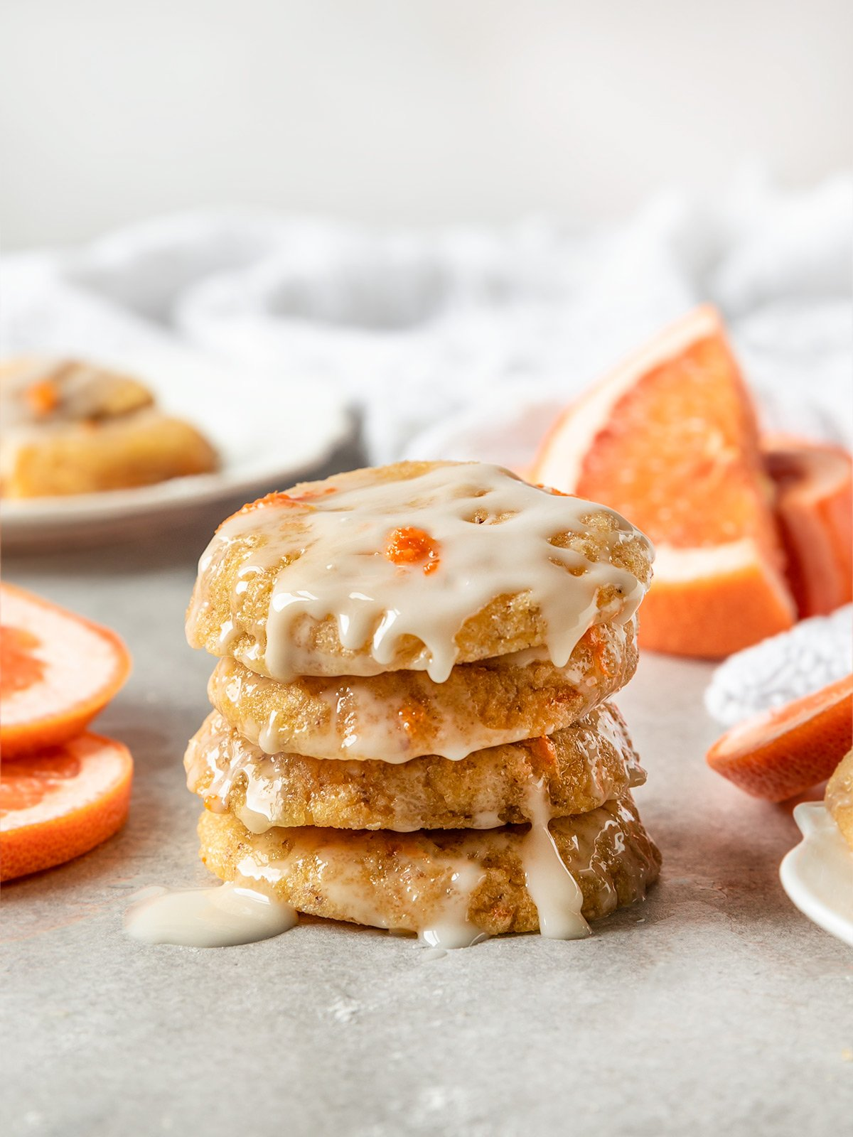 stack of grapefruit cookies with grapefruit icing and grapefruit zest on top