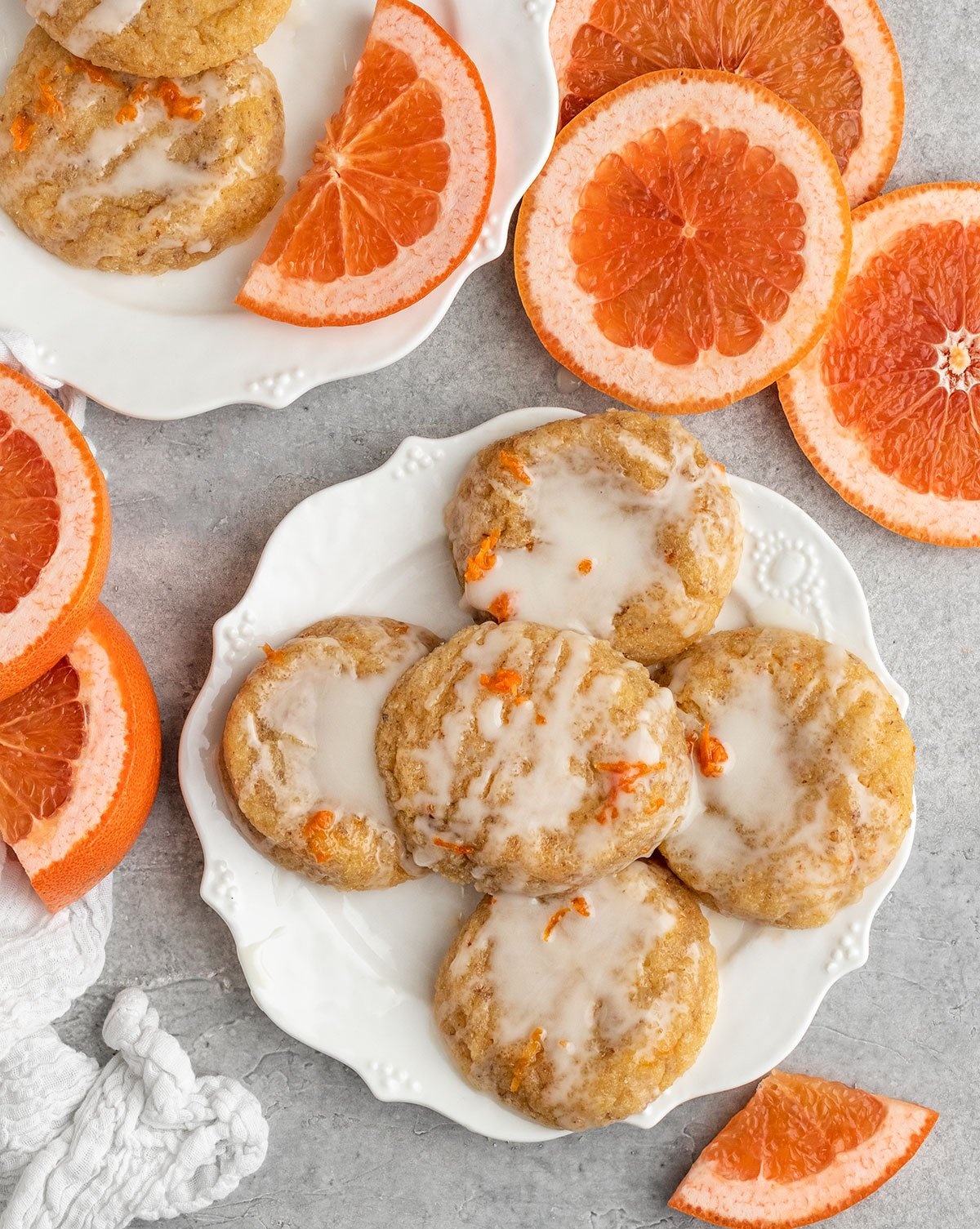 plate of grapefruit cookies with fresh grapefruit slices, zest, and icing on top