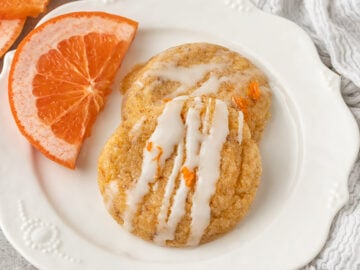 plate of grapefruit cookies with fresh grapefruit slices and icing