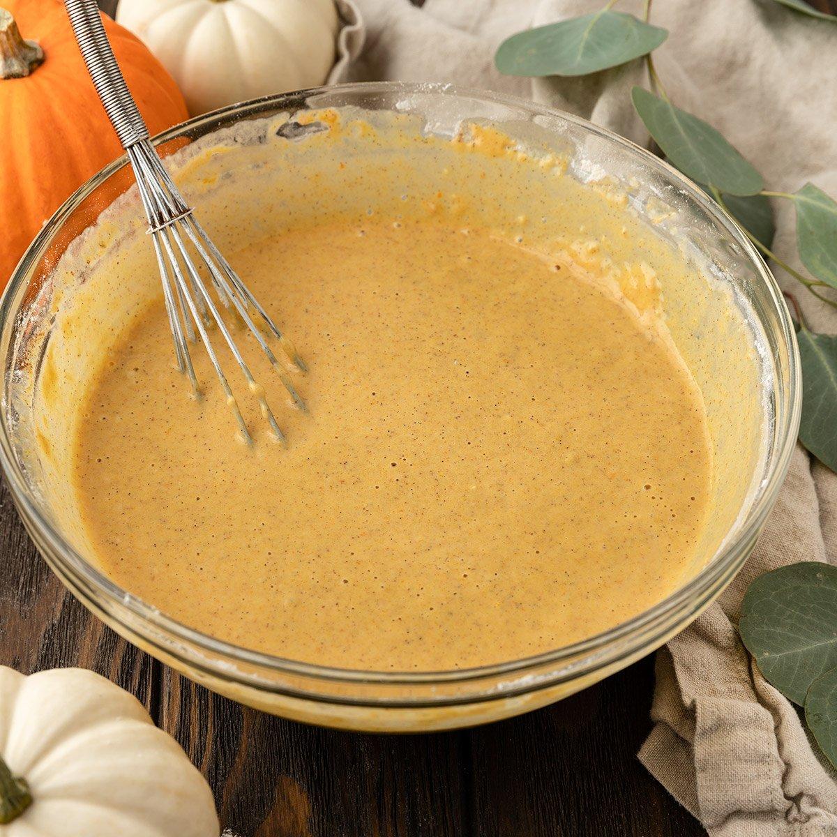 pumpkin pancake batter in mixing bowl