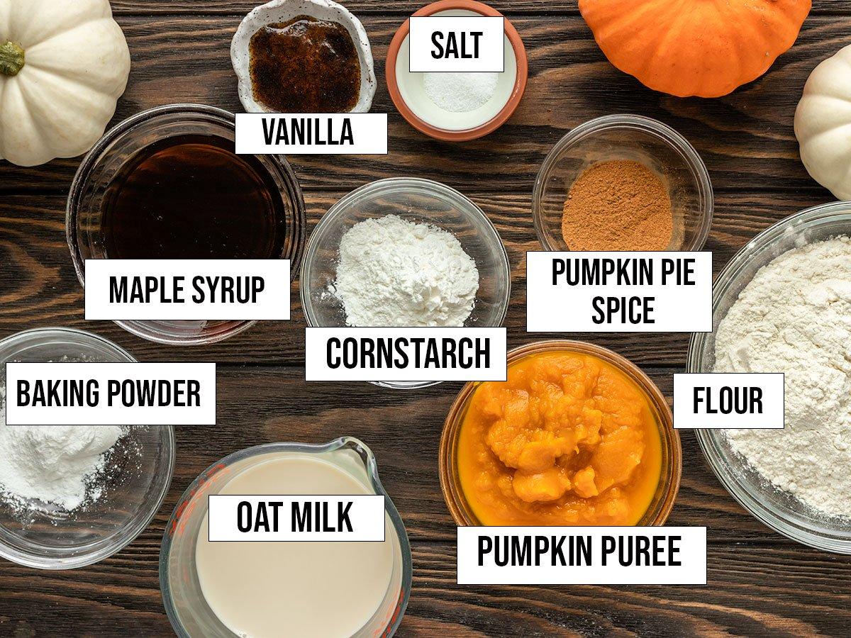 ingredients like pumpkin puree, pumpkin pie pie, flour, maple syrup, cornstarch, oat milk, vanilla, salt, baking powder, and pumpkin pie spice