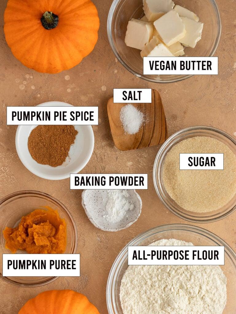 labeled ingredients like pumpkin puree, flour, sugar, baking powder, vegan butter, sugar, baking powder, and salt