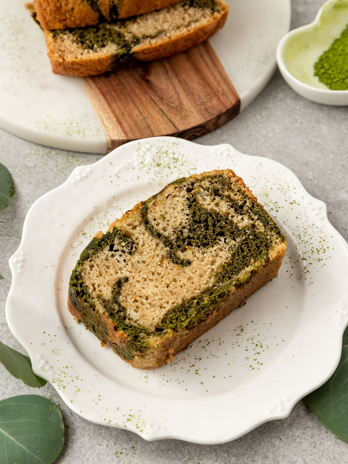 slice of matcha and vanilla marble bread on a plate