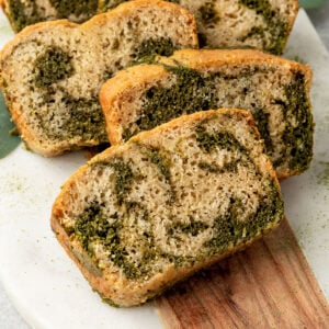 slices of matcha vanilla marble bread on a board