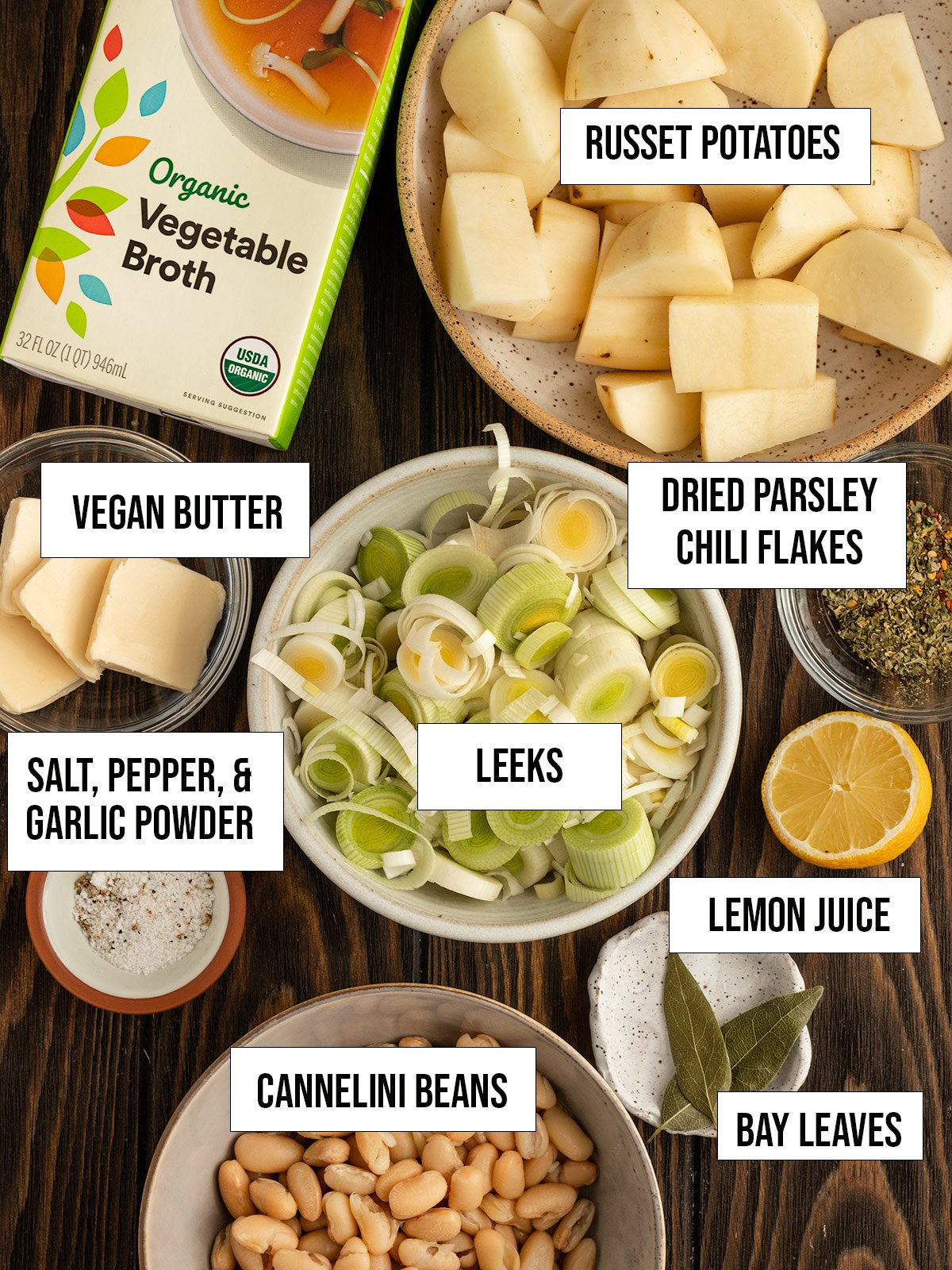 ingredients including potatoes, leeks, vegetable broth, spices, vegan butter, lemon juice, and cannelini beans