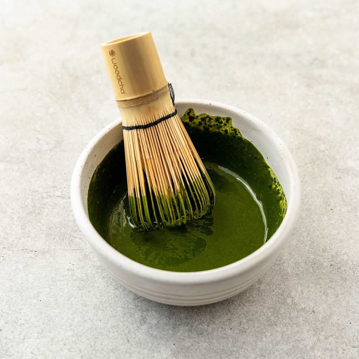 whisking matcha in a bowl